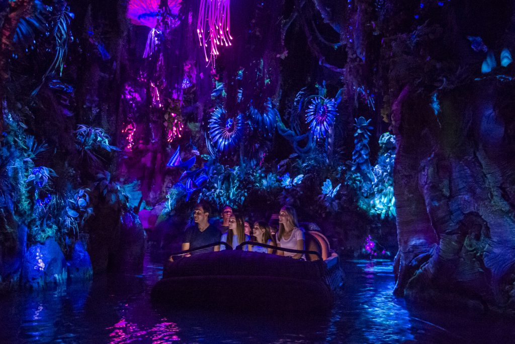 Pandora The World of AVATAR attractions include the family-friendly NaÕvi River Journey. The adventure begins as guests sail in reed boats down a mysterious, sacred river hidden within the bioluminescent rainforest. The full beauty of Pandora reveals itself as the boats pass by exotic glowing plants and amazing creatures.