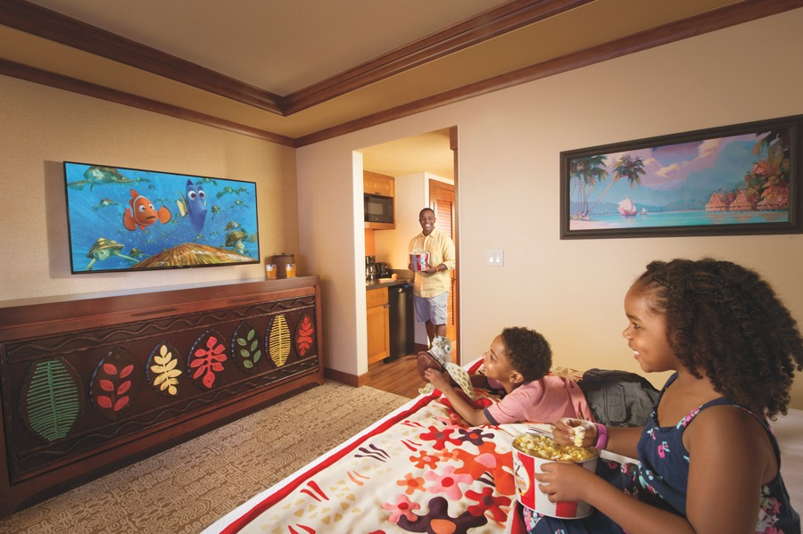 Family watches movie in a Disney Resort Hotel room