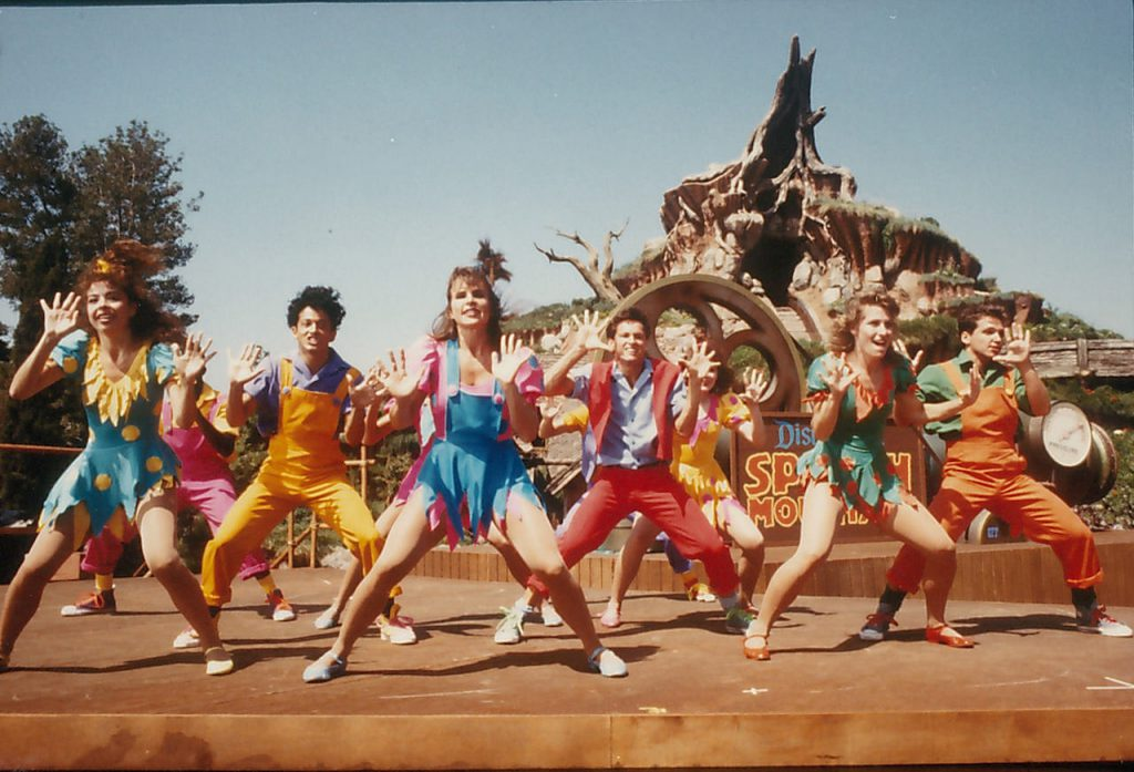 Dancers in front of Splash Mountain at Disneyland Park