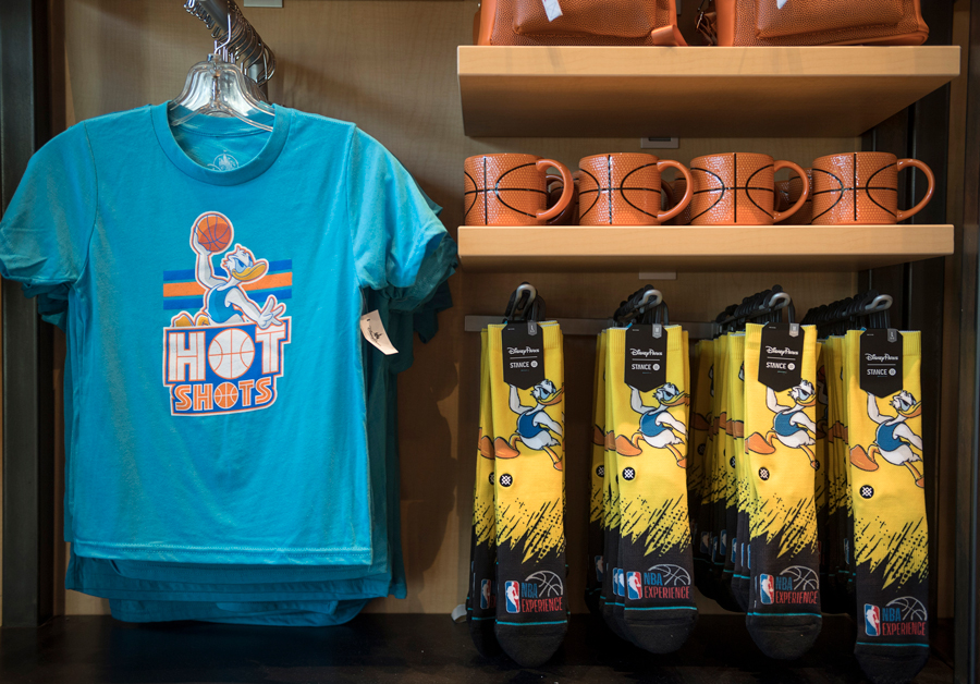 Donald Duck t-shirt and socks and basketball mugs in the NBA Store inside NBA Experience at Disney Springs