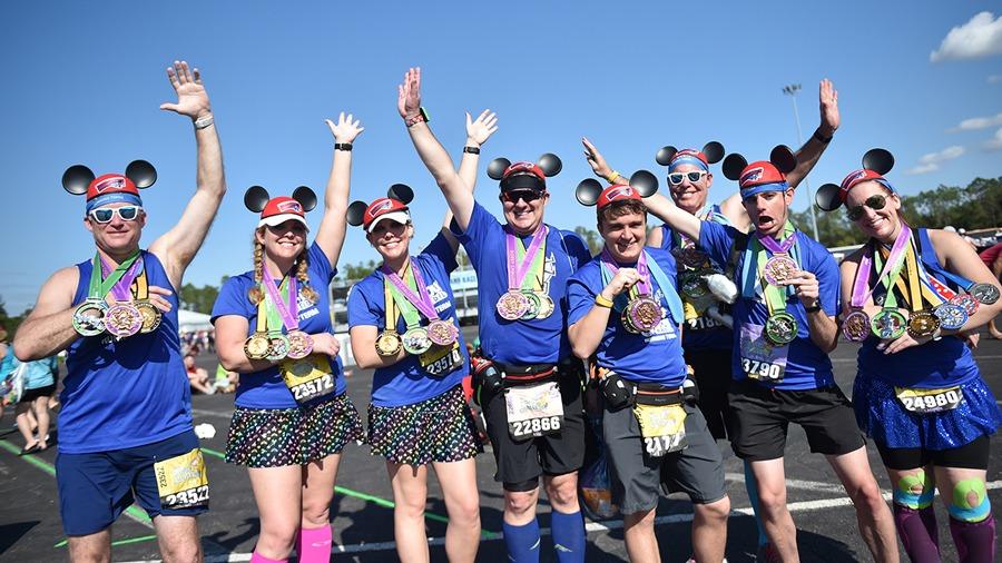 Runners display their runDisney medals