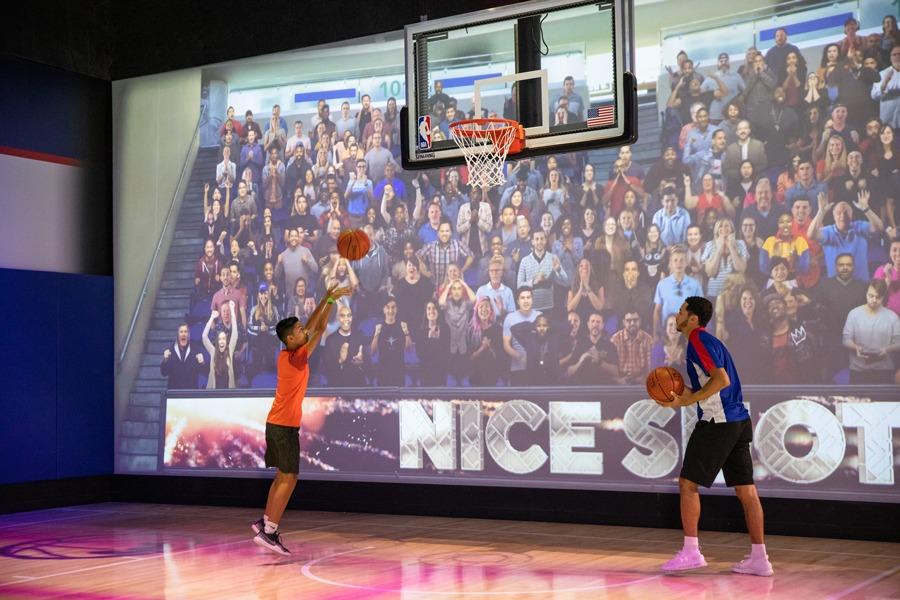 Shooting basketballs at the NBA Experience at Disney Springs