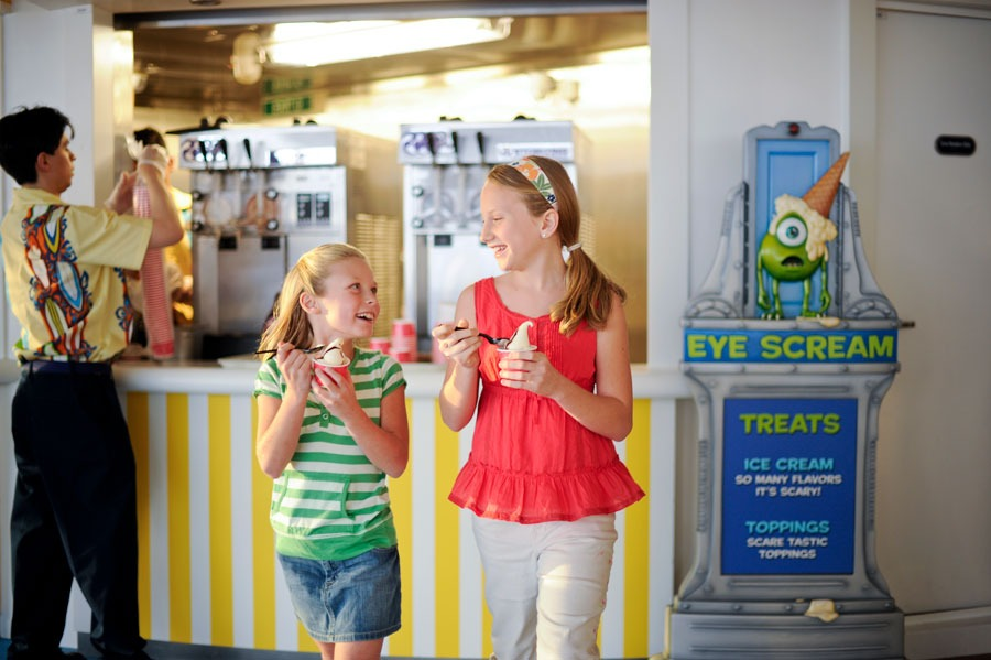 Two girls eating ice cream at Eye scream Treats aboard the Disney Dream