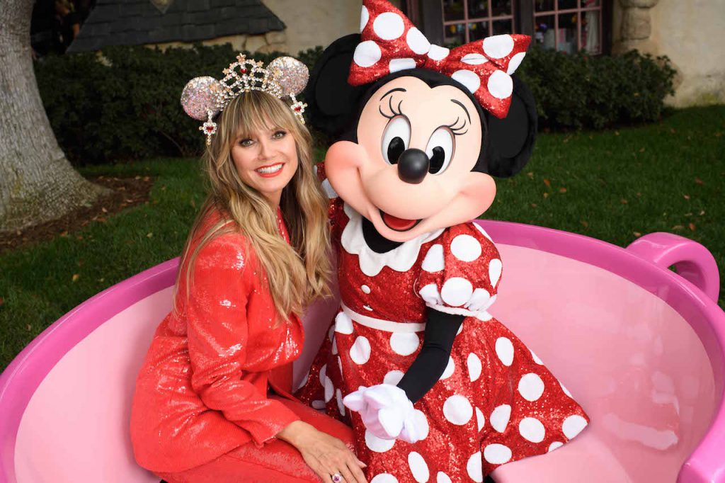 Legendary supermodel, television host and entrepreneur Heidi Klum embraces global star and fashion icon Minnie Mouse Sept. 28, 2019, at Disneyland in Anaheim, Calif., as she celebrates the launch of and dons her personally designed luxurious Minnie Mouse headband studded with 150 Swarovski crystals. Klum's limited release design for the Disney Parks Designer Collection is available at Disneyland Resort in California, Walt Disney World Resort in Florida and on ShopDisney.com.