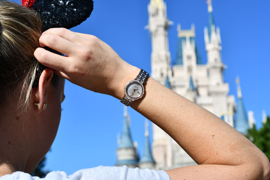 Citizen watch featuring Cinderella Castle modeled in front of Cinderella Castle