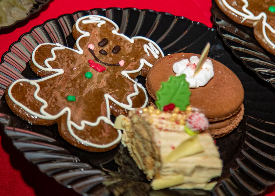 Holiday desserts, including Hot Cocoa Marshmallow Macarons, Churros Yule Logs and Mickey Gingerbread Men
