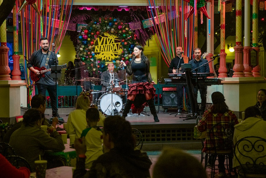 The Tina Aldana Band performs at the Disney Parks Blog Holiday 2019 Meet-Up
