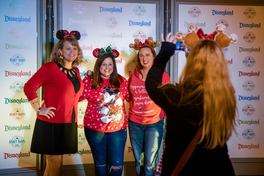 Guests take a photo at the Disney Parks Blog Holiday 2019 Meet-Up