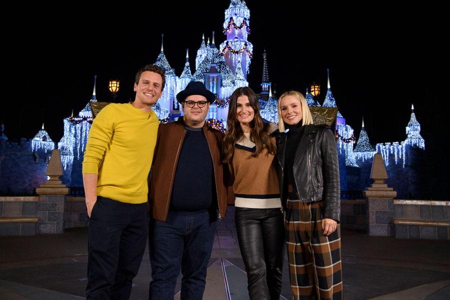 Kristen Bell, Idina Menzel, Jonathan Groff and Josh Gad pose in front of Sleeping Beauty Castle at Disneyland park