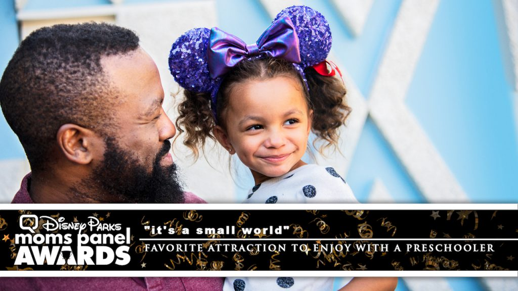 """Father and Daughter at """"it's a small world"""" at the Disneyland Resort"""
