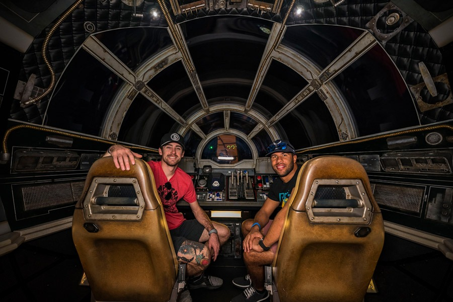 NASCAR Cup Series Drivers Ryan Blaney and Bubba Wallace pilot the Millennium Falcon in Star Wars: Galaxy's Edge