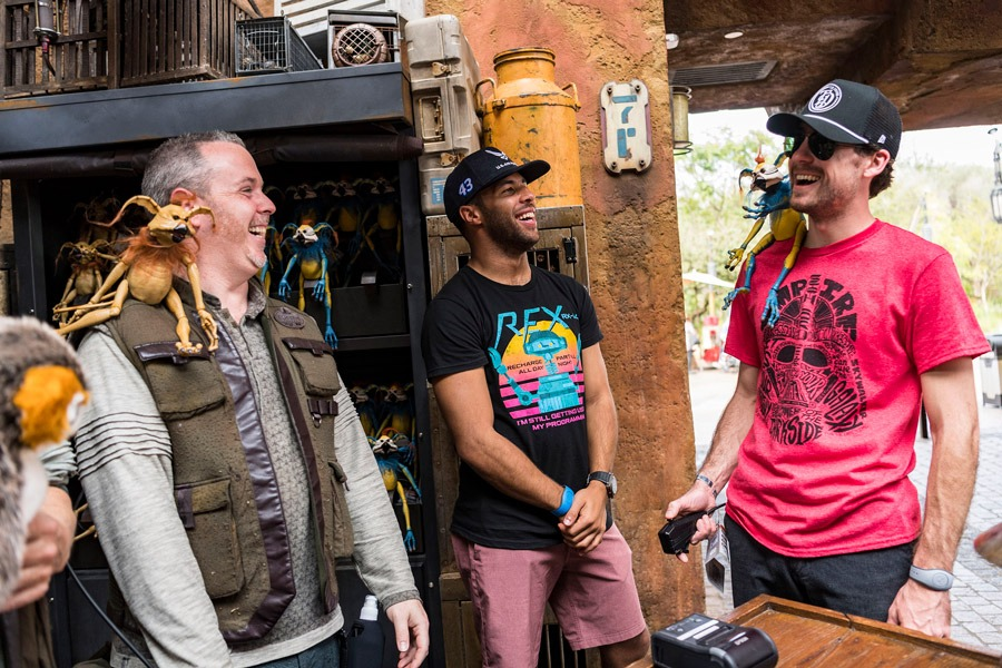 NASCAR Cup Series Drivers Ryan Blaney and Bubba Wallace stop at a merchant shop in Star Wars: Galaxy's Edge