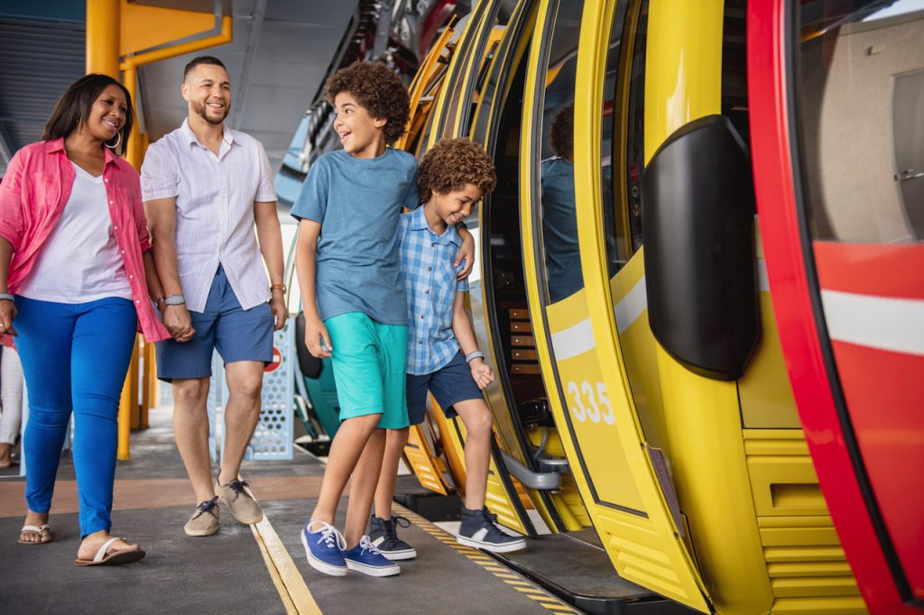 Family getting on Disney Skyliner