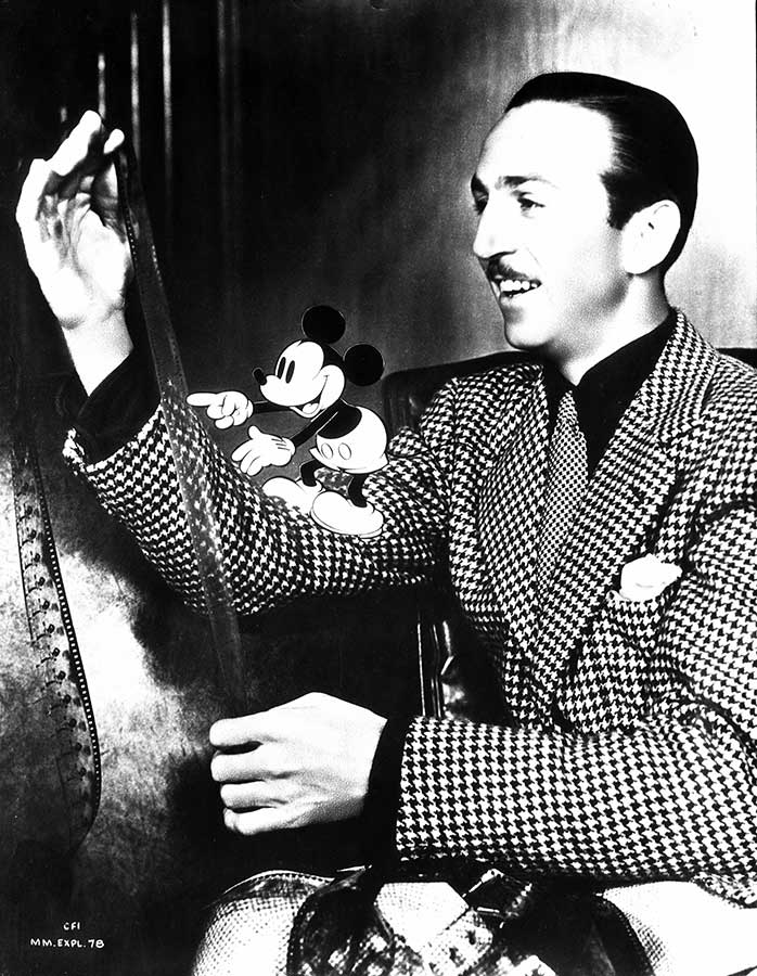 Walt Disney and his alter ego confer in this 1949 publicity pose.