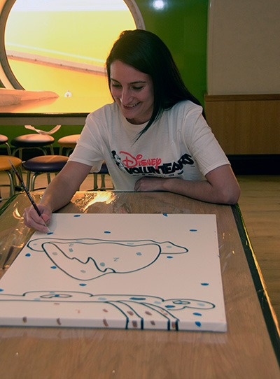 Creating murals, inspired by classic Disney characters and movies