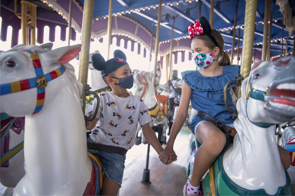 Young guests on Prince Charming Regal Carrousel at Magic Kingdom Park