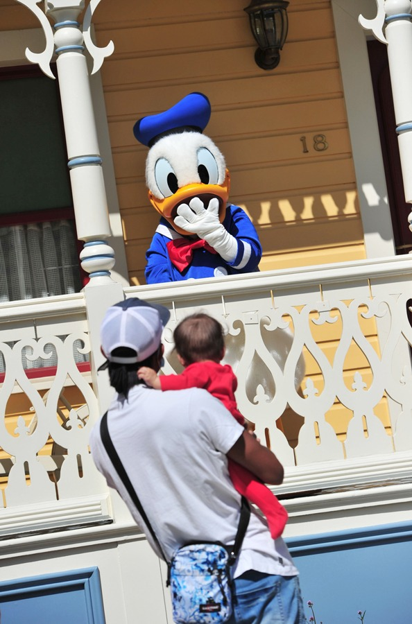 Guests wave to Donald Duck at Disneyland Paris