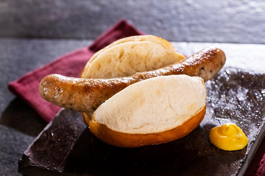 Offerings from Germany Marketplace for the 2020 Epcot Taste of International Food & Wine Festival - Roast Bratwurst in a Prop & Peller® Pretzel Roll