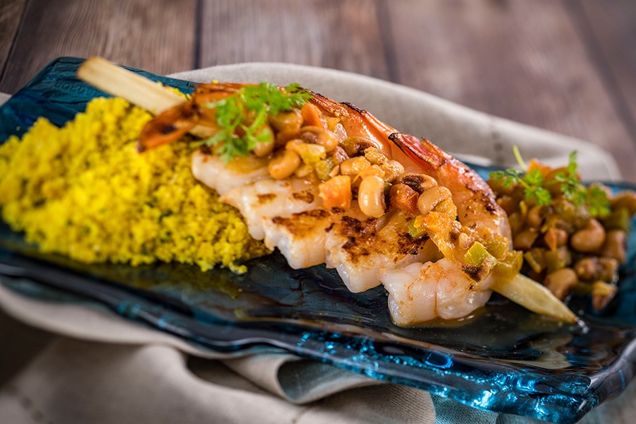 Offerings from Africa Marketplace for the 2020 Epcot Taste of International Food & Wine Festival - Piri Piri Skewered Shrimp with Citrus-Scented Couscous