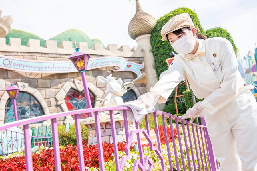 Tokyo Disney Resort cast member cleans as part of enhanced health and safety measures