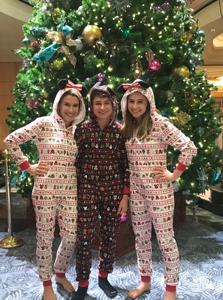 Family in Christmas outfits on a Disney Cruise Line ship