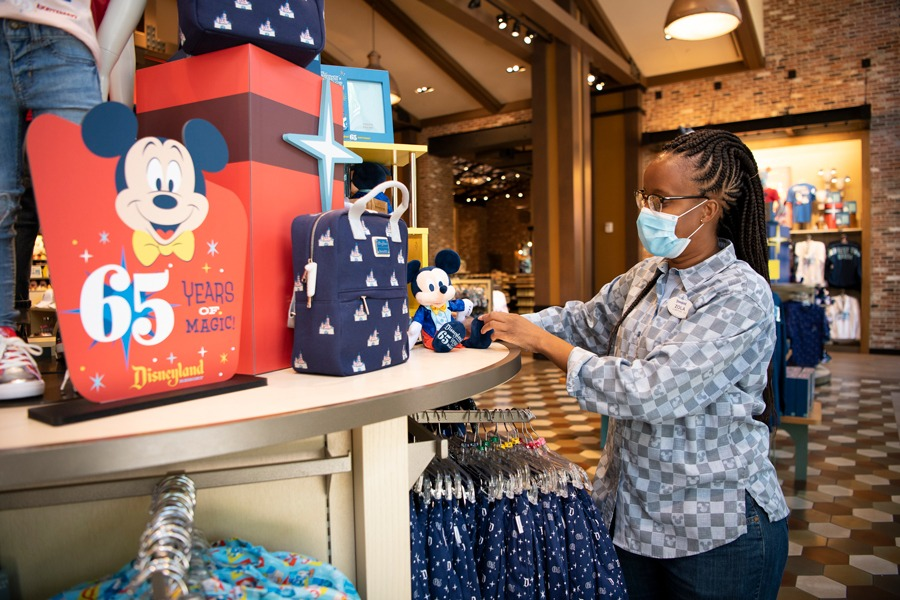 Cast member in World of Disney store in the Downtown Disney District at Disneyland Resort