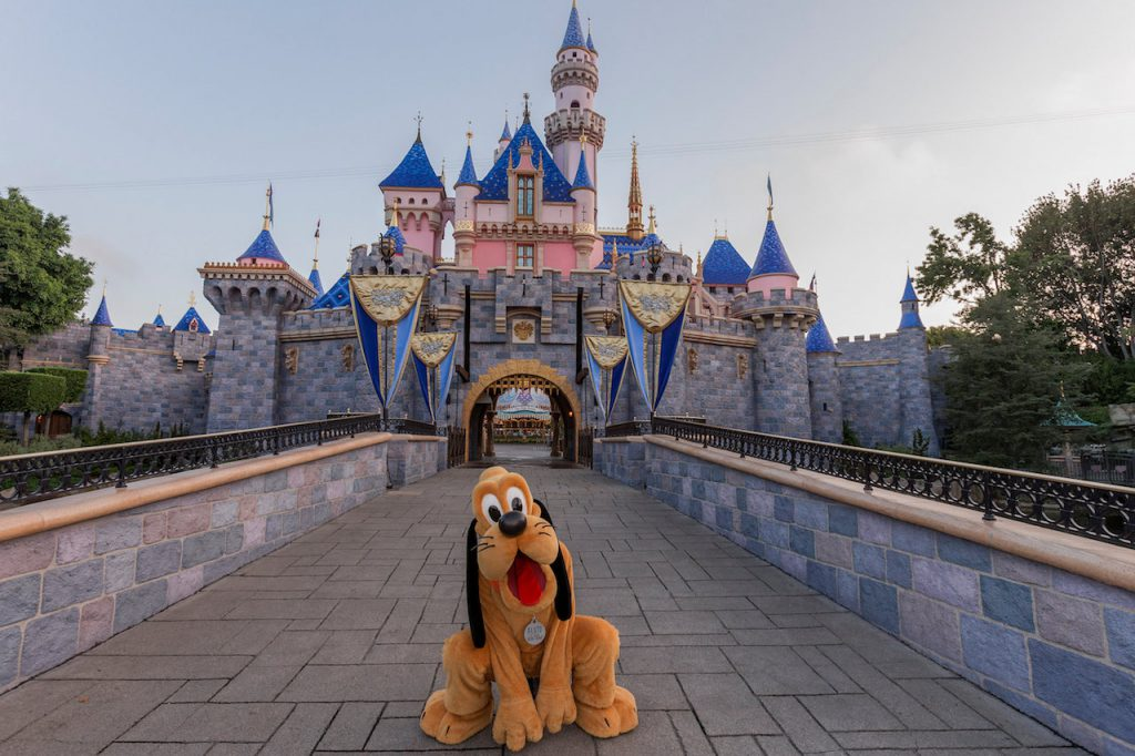Pluto in front of Sleeping Beauty Castle at Disneyland Resort