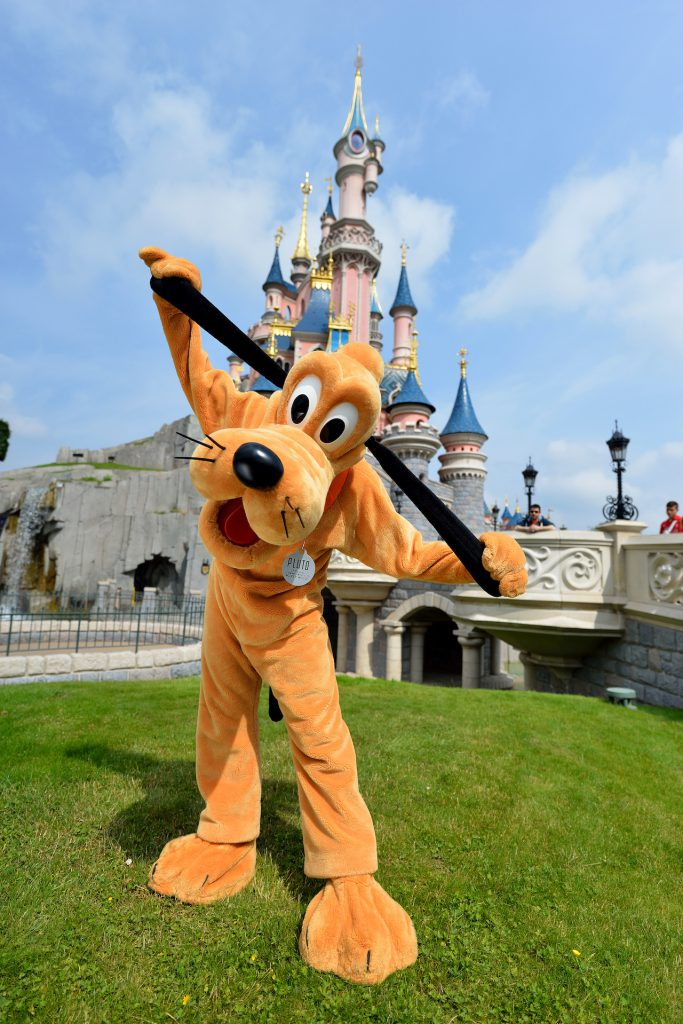 Pluto in front of Sleeping Beauty Castle at Disneyland Paris