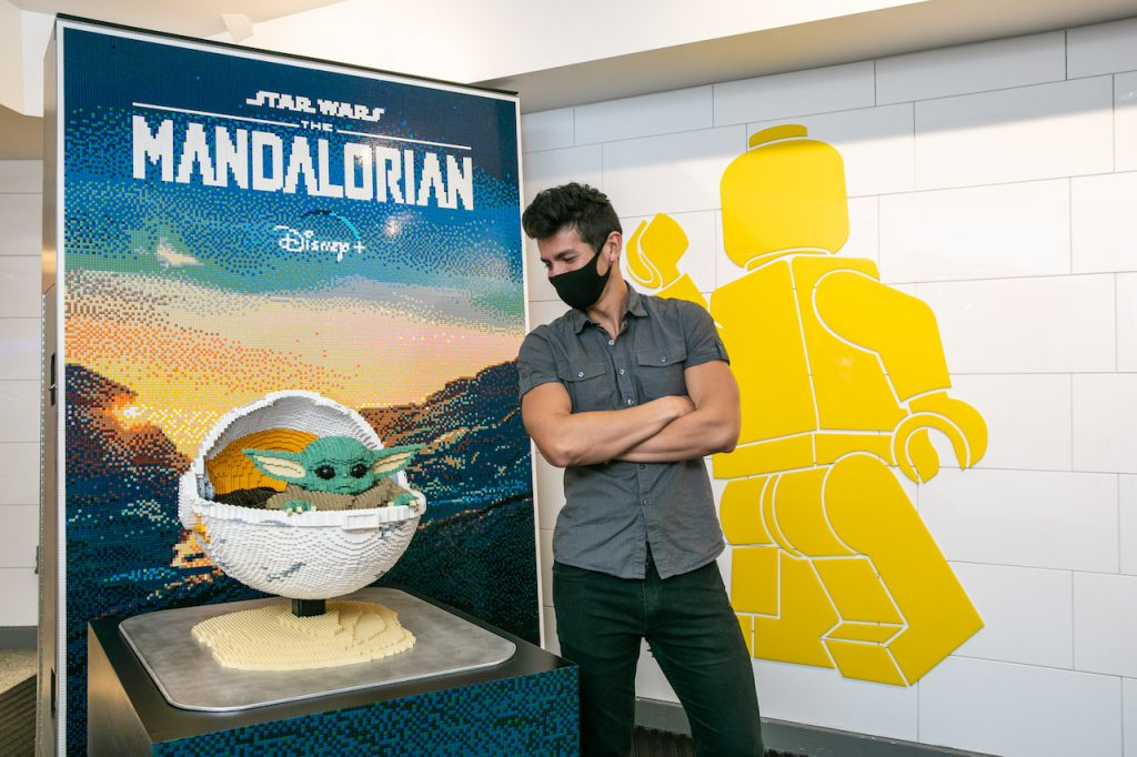 "one-of-a-kind LEGO mural inspired by ""The Mandalorian"" in the LEGO Store lobby at Disney Springs"