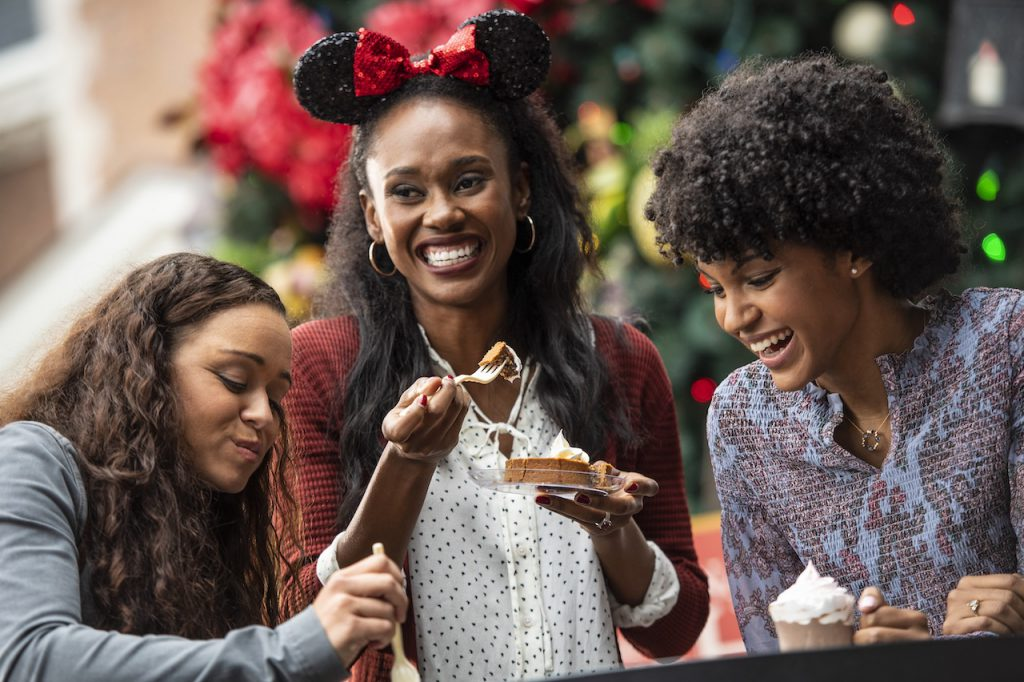 Friends eating at EPCOT during the holidays
